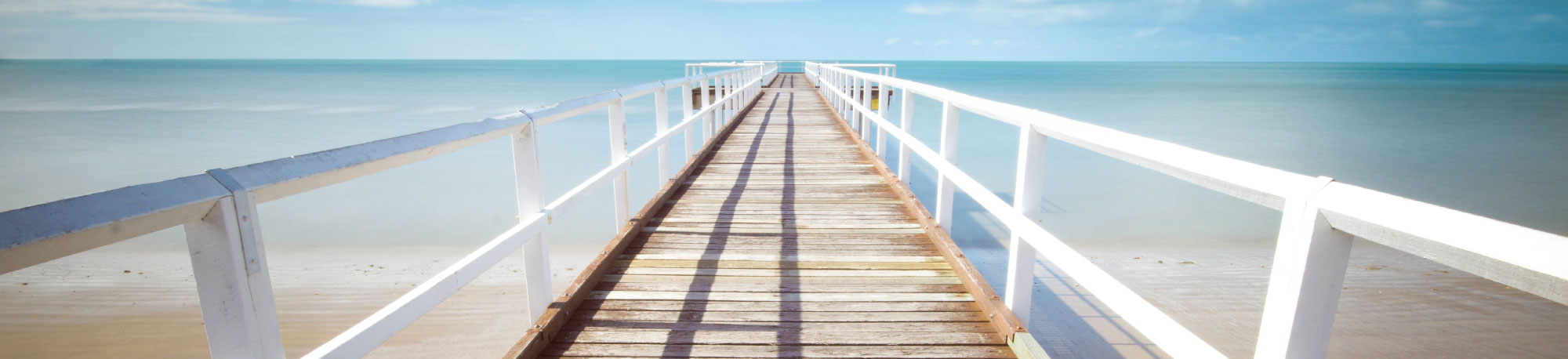 Banner image of a walkway at a beach