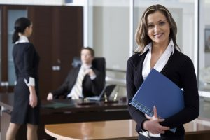Female Attorney holding a file in Jacksonville, FL